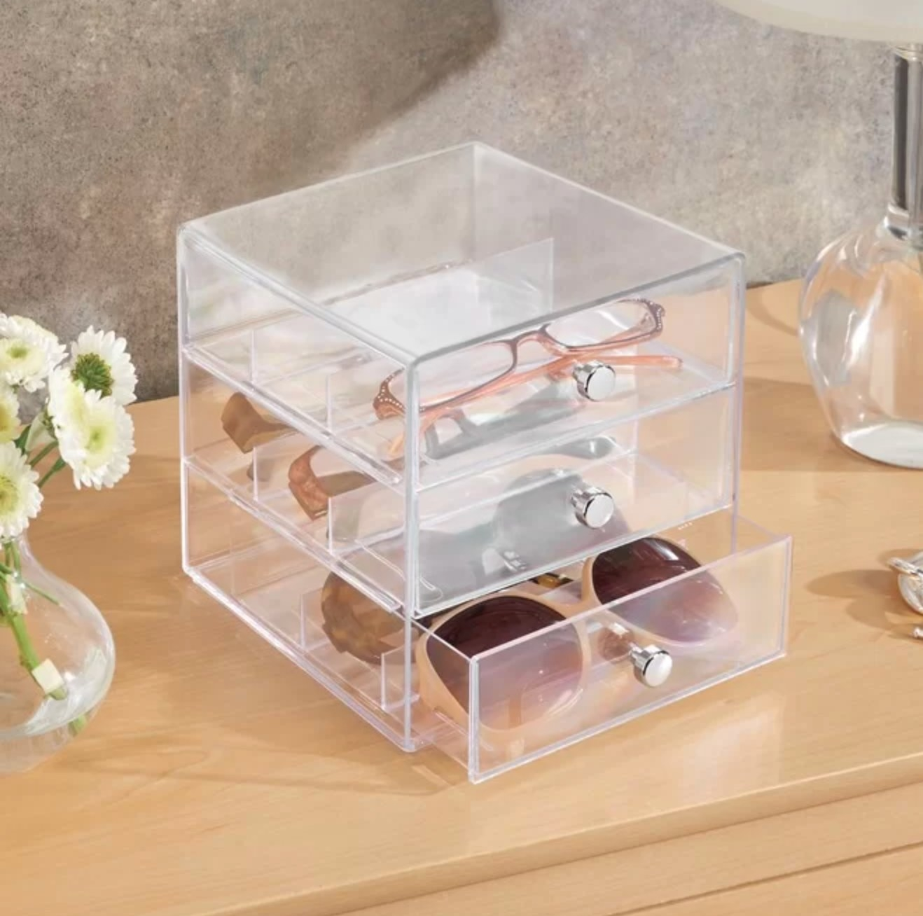 The sunglass organizer in clear plastic