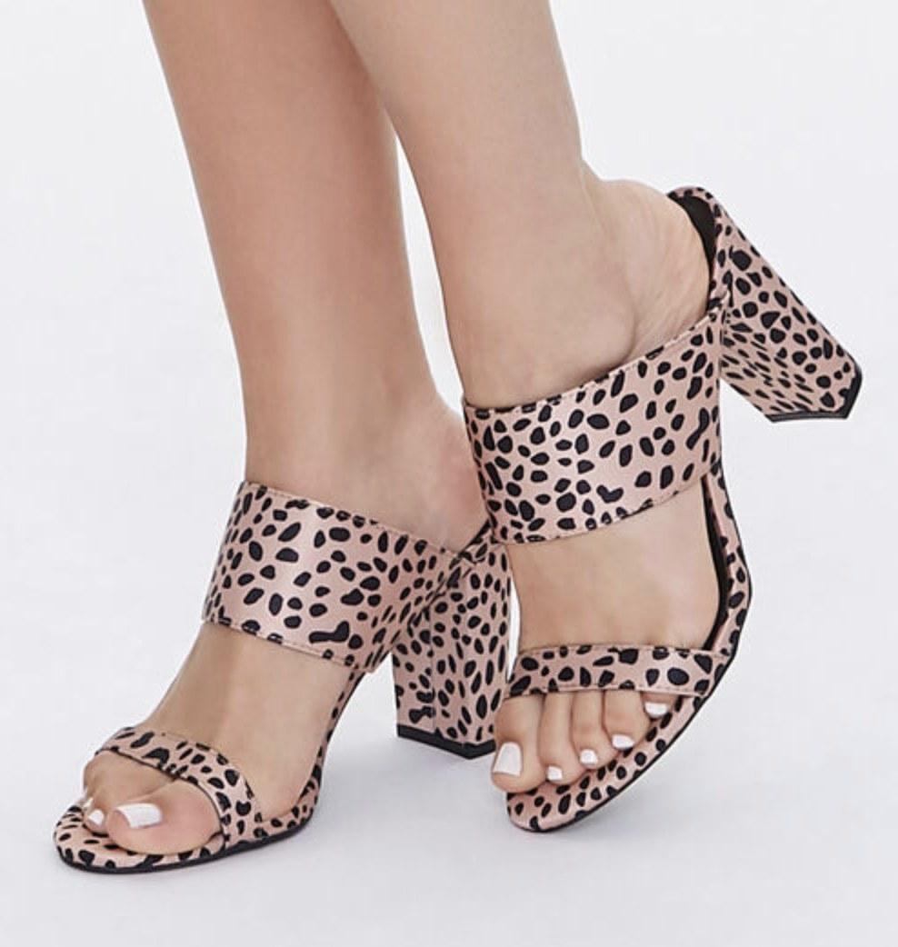 Model is wearing cheetah print block heels