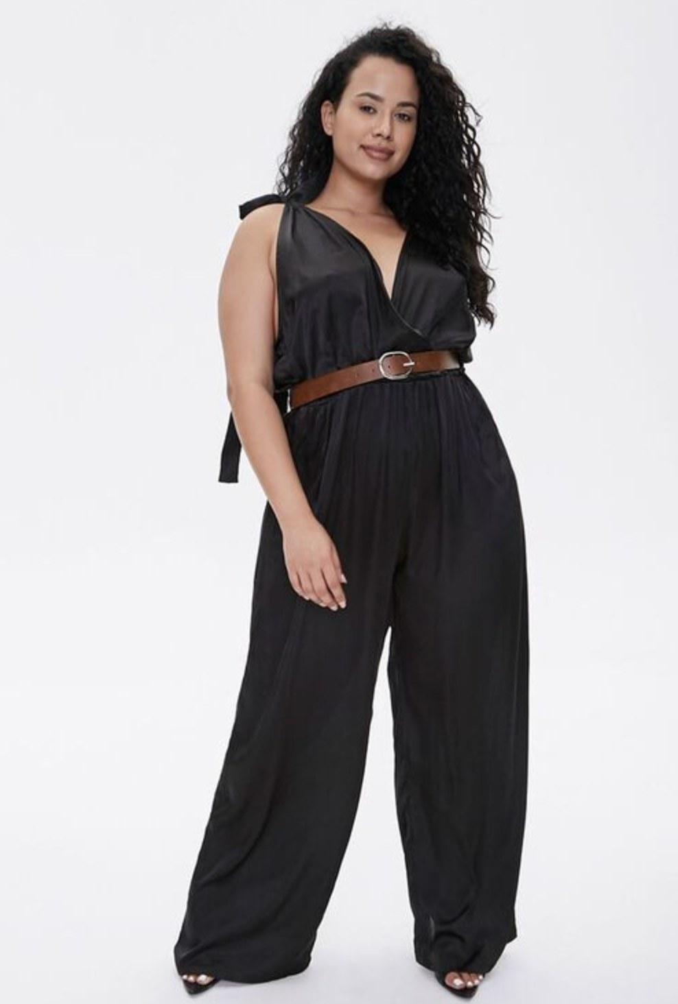 Model is wearing a black jumpsuit