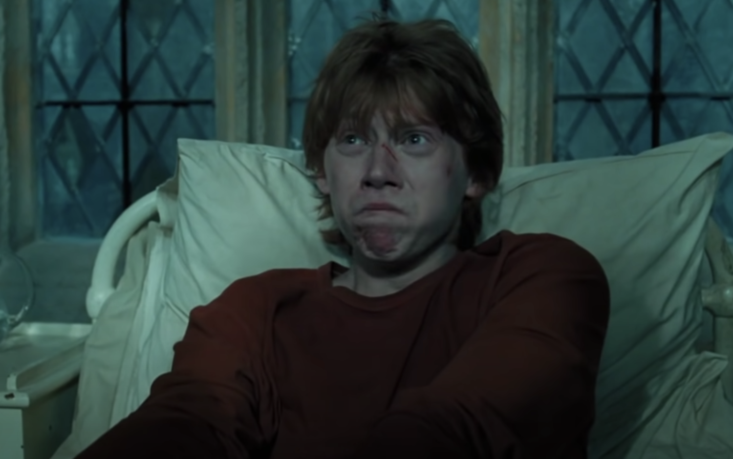 Ron in pain in a hospital bed
