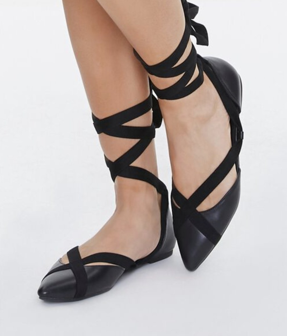 Model is wearing black lace-up flats