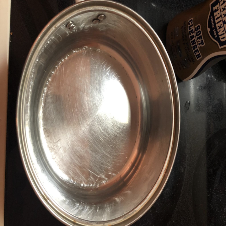 the same pot now completely clean of the black burnt bits