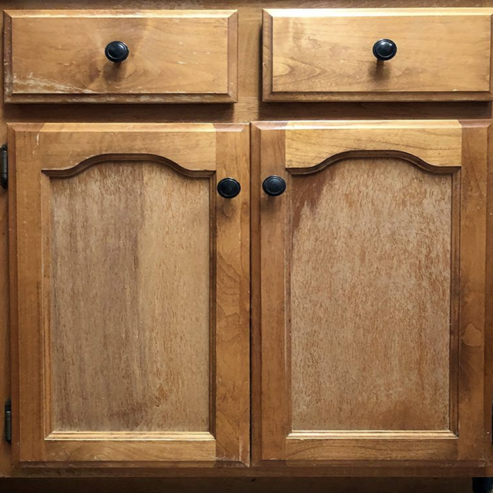 a reviewer's wooden cabinets looking worn out