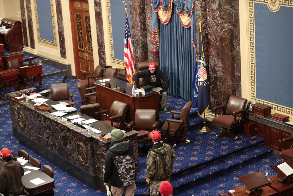 Several rioters walking freely inside the Senate chamber