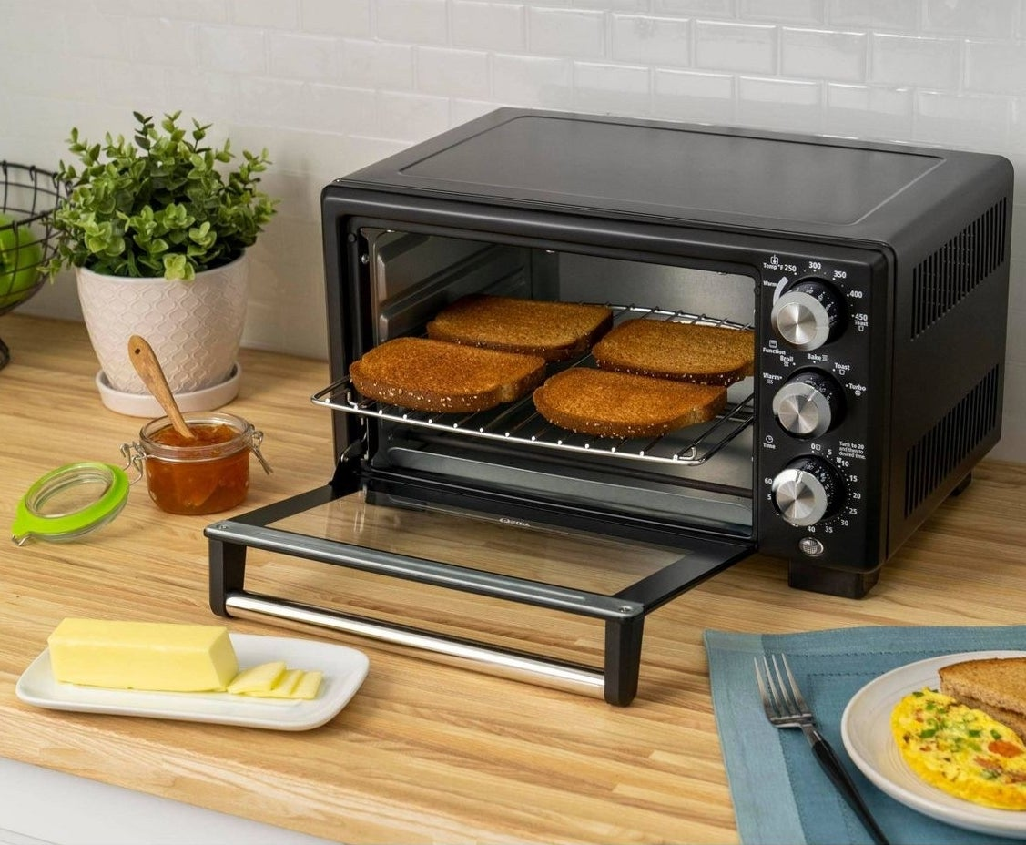 black toaster oven with four slices of bread inside