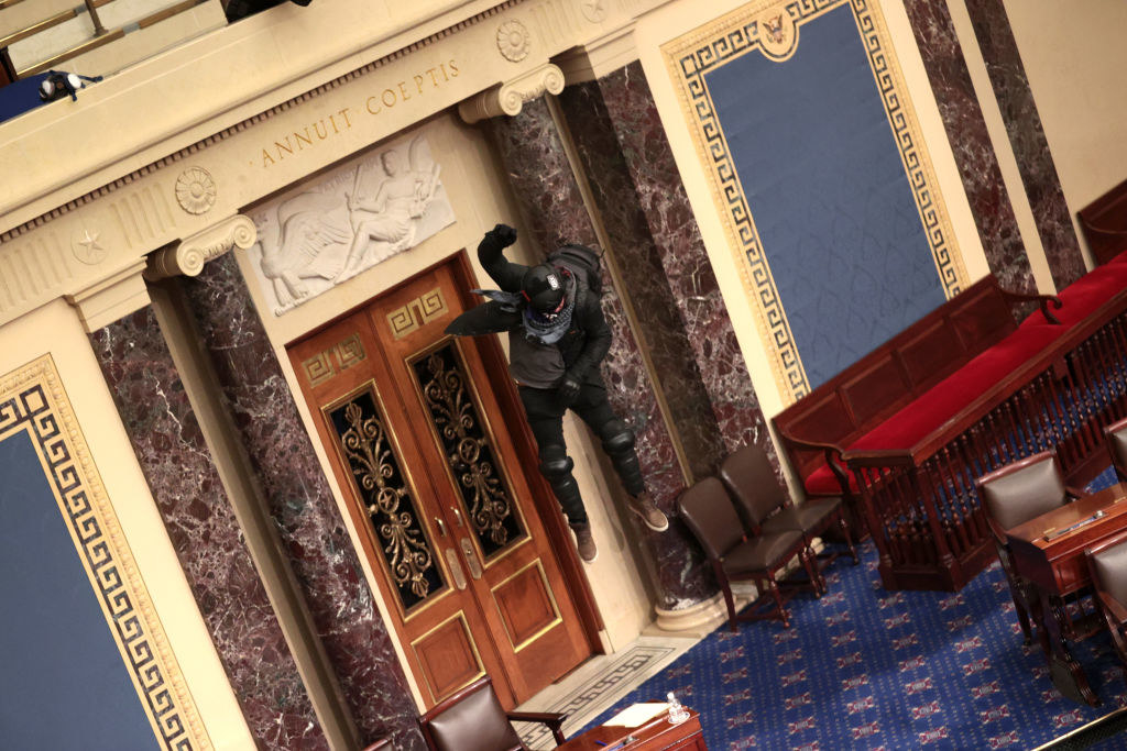 Rioter jumps from balcony to the floor inside the Senate chamber