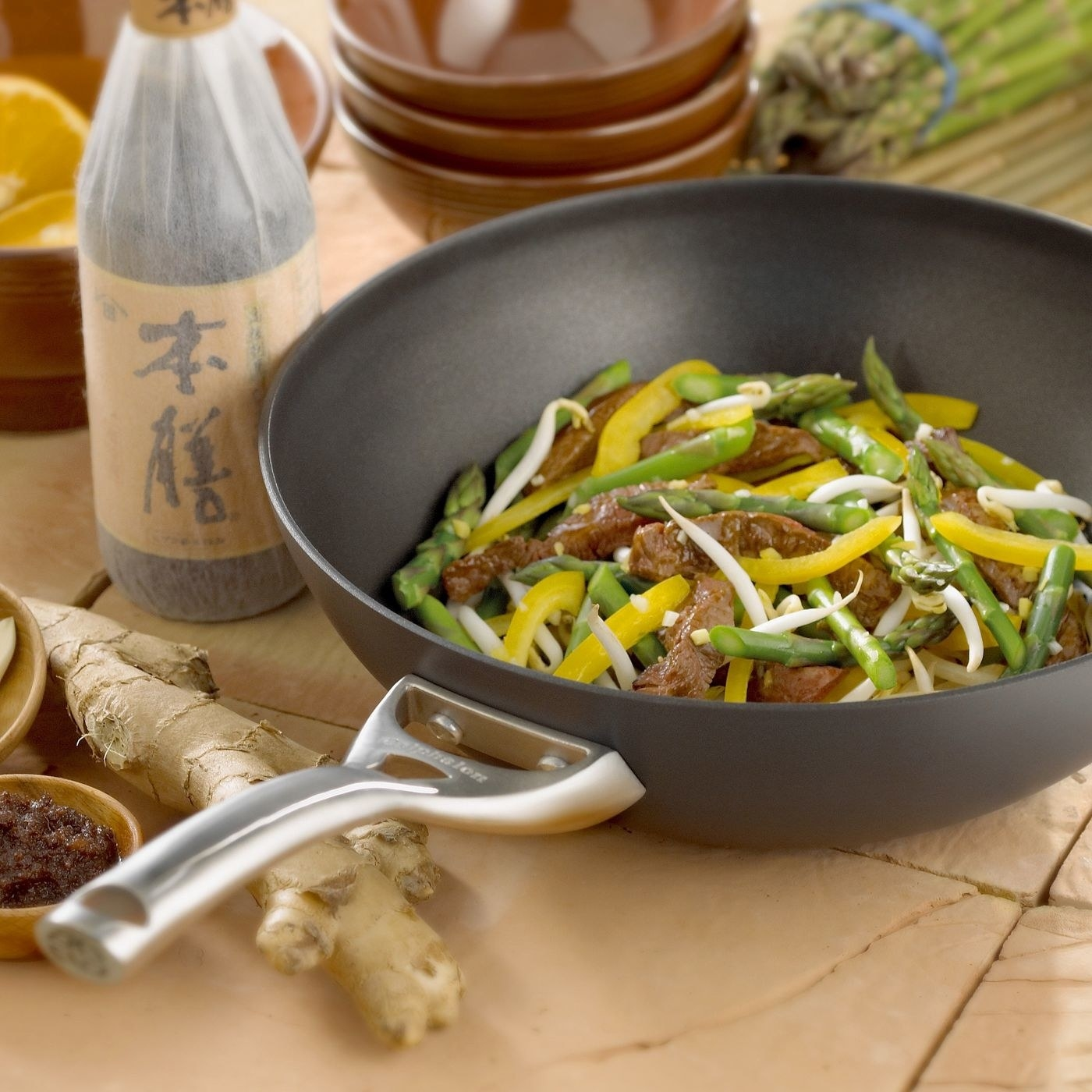 stainless steel wok with beef and vegetables in the wok