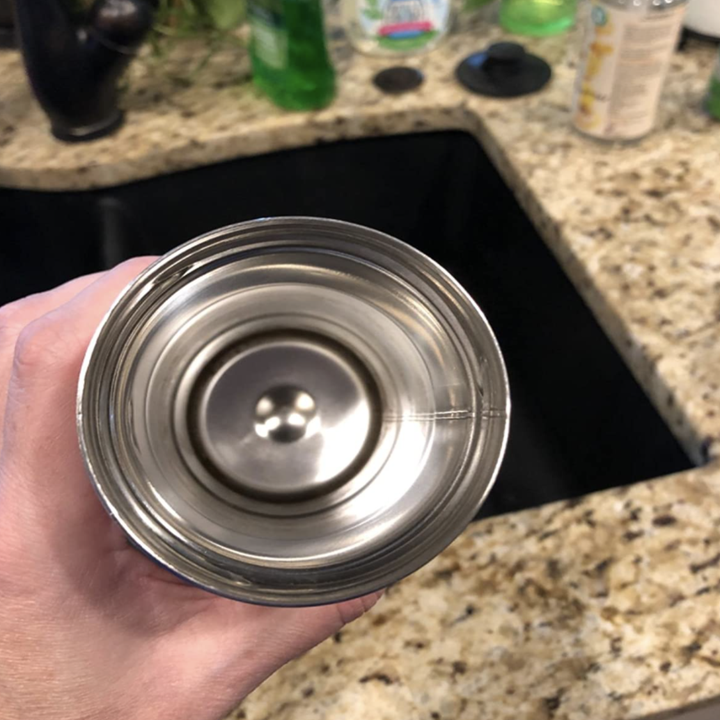The same reviewer's water bottle now looking shiny and clean after using the cleaning tablet
