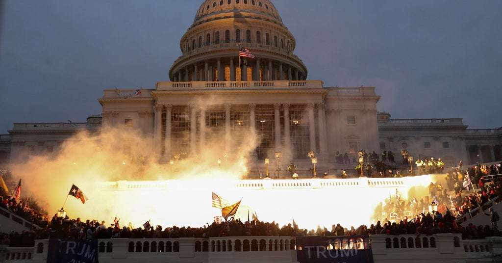 Photo of The world reacts to Trump mob violence in the U.S. Capitol in Washington, D.C.