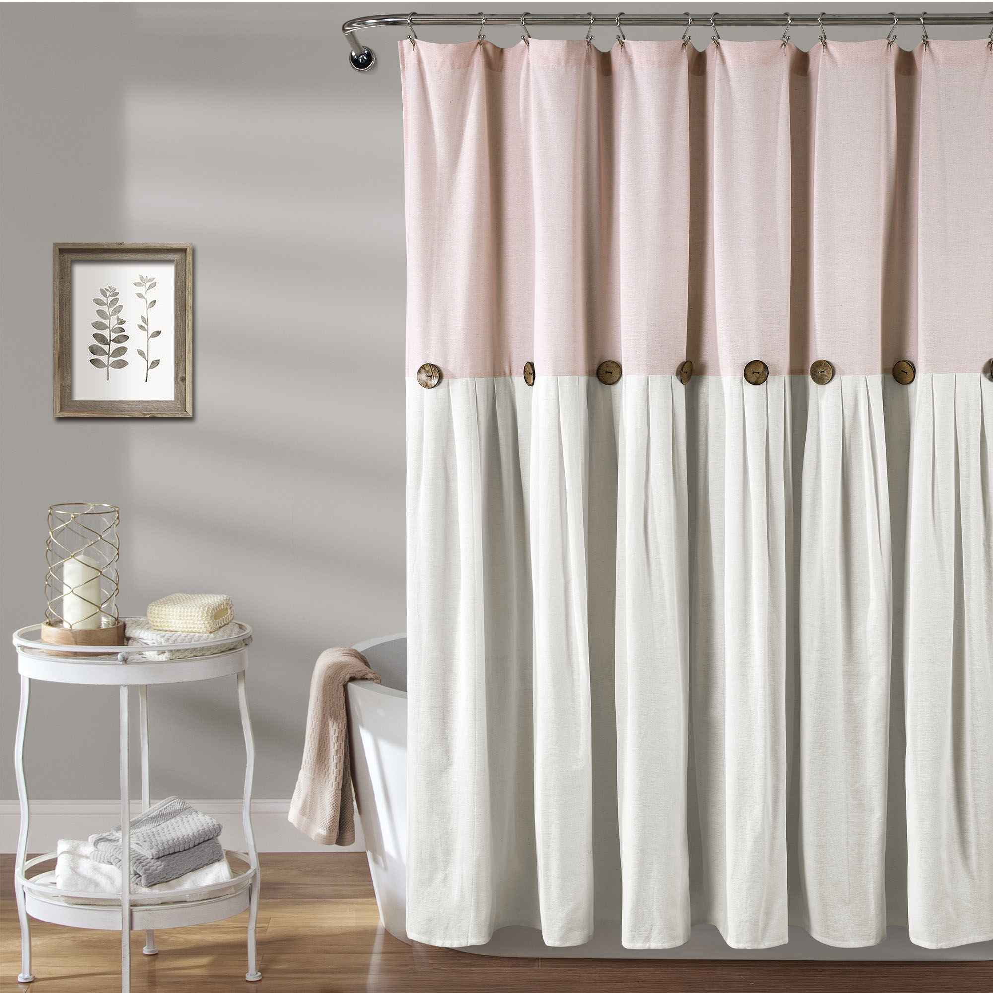 The linen curtain, in pink and white, which has button flourishes across the center