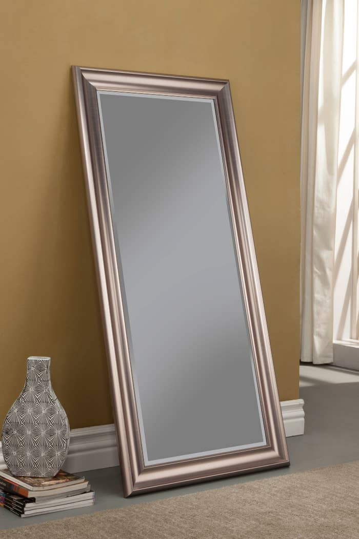 The mirror, which is long and rectangular, in rose-gold frame