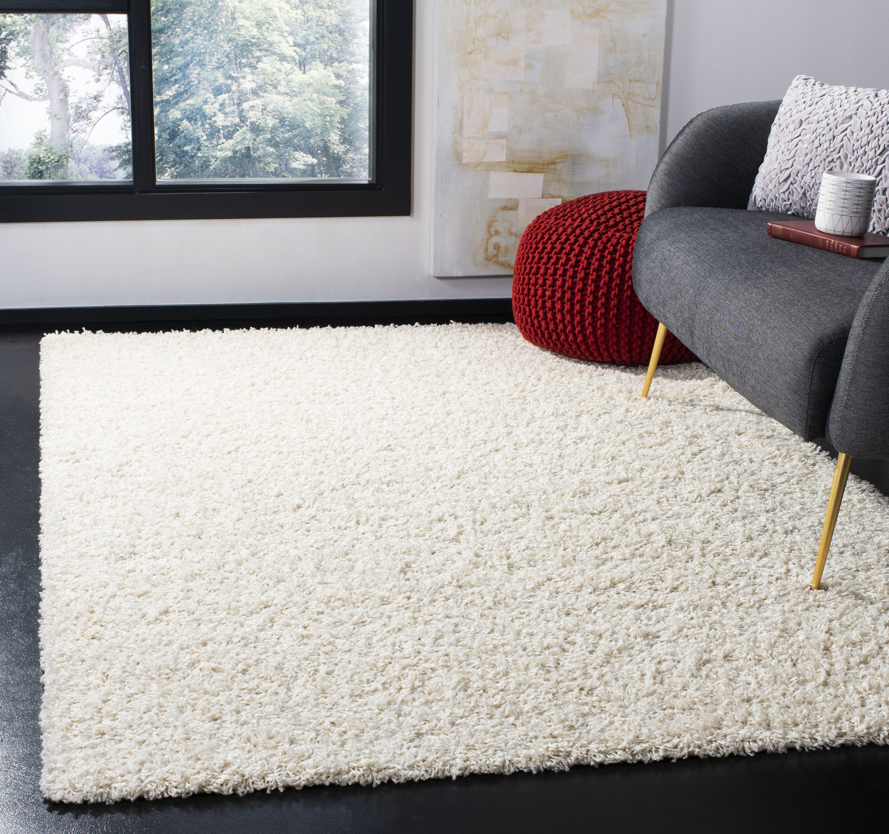 The rug, which has a shag texture, in a square size, in white