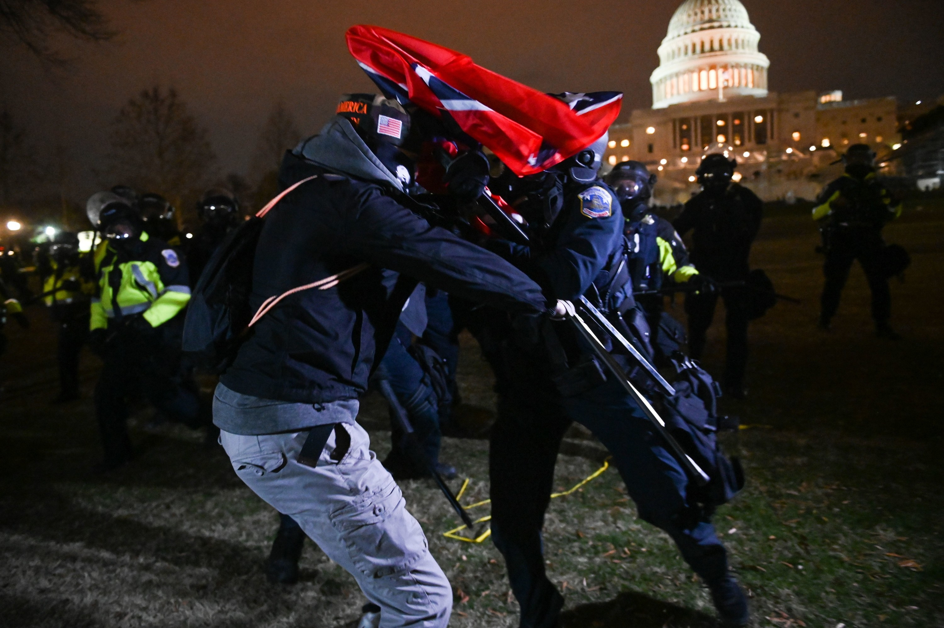 Rioter struggling with police