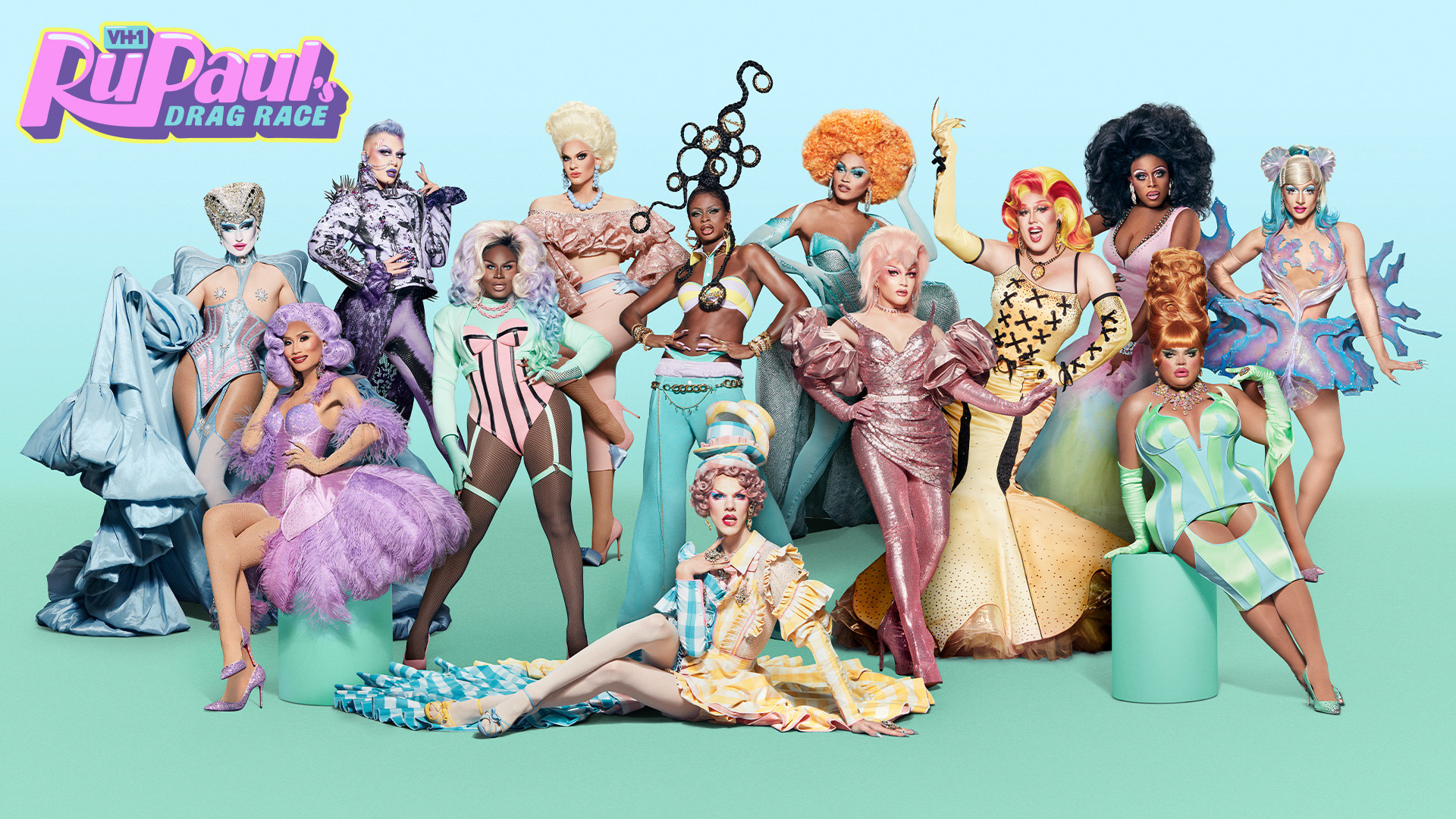 Promotional photo of the entire cast dressed in pastel colors with a teal background