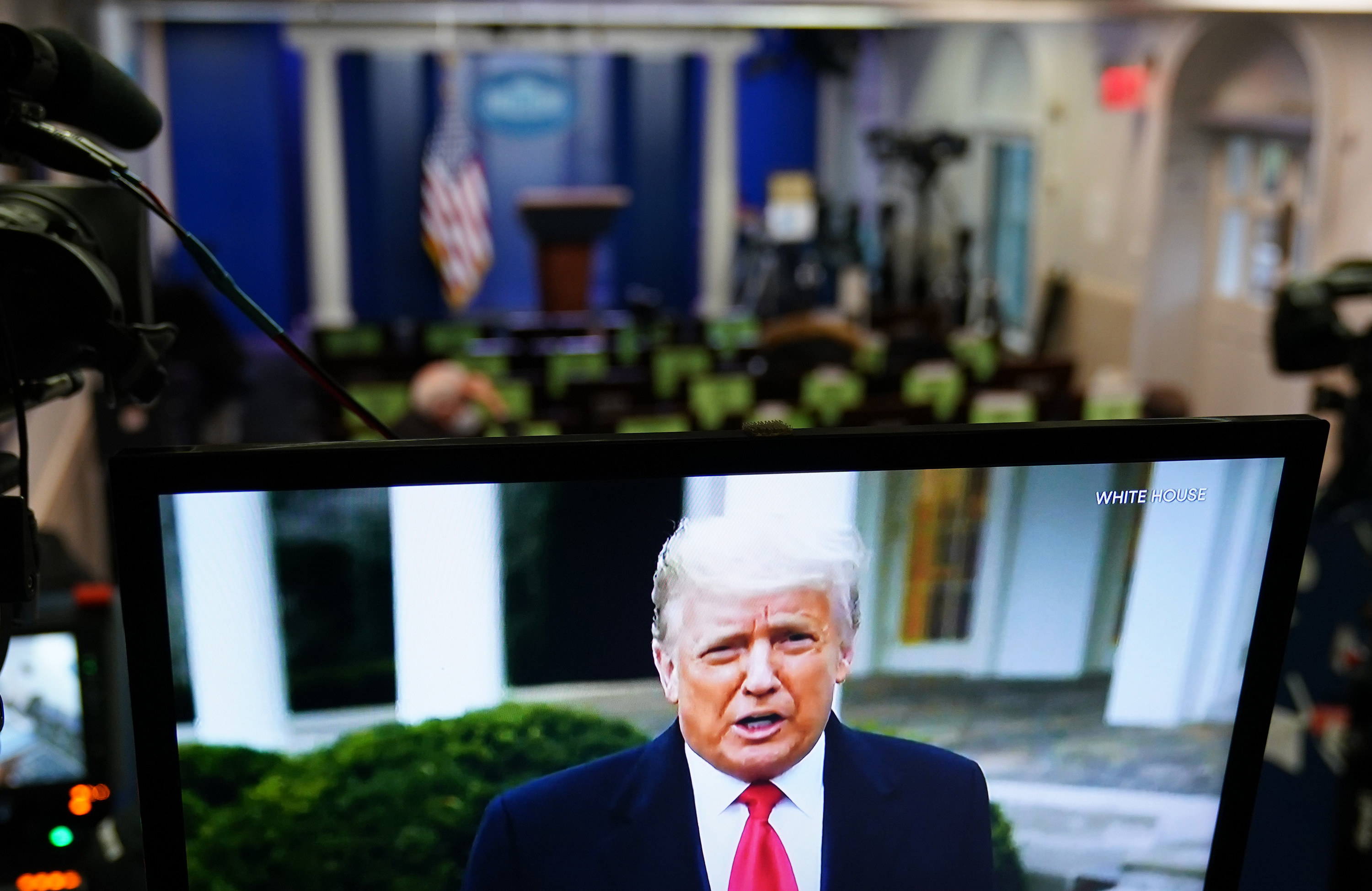 President Donald Trump is seen on a TV in the White House's press briefing room