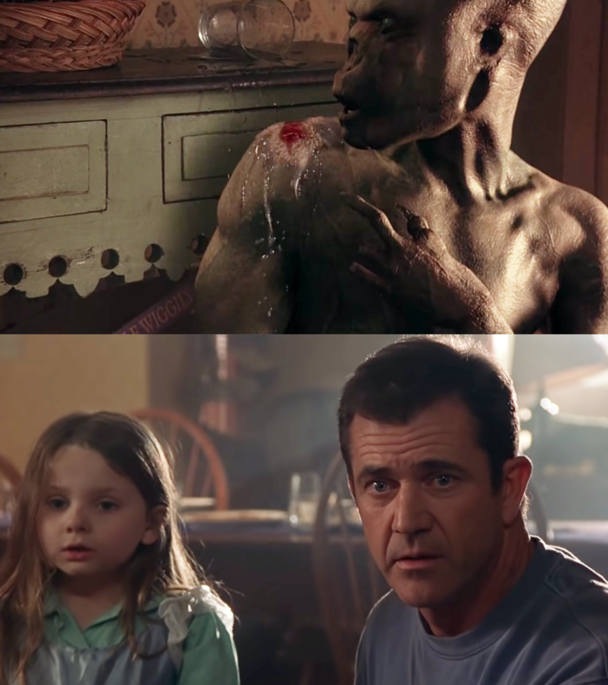 """Mel Gibson as Father Graham Hess and Abigail Breslin as Bo Hess in the movie """"Signs."""""""