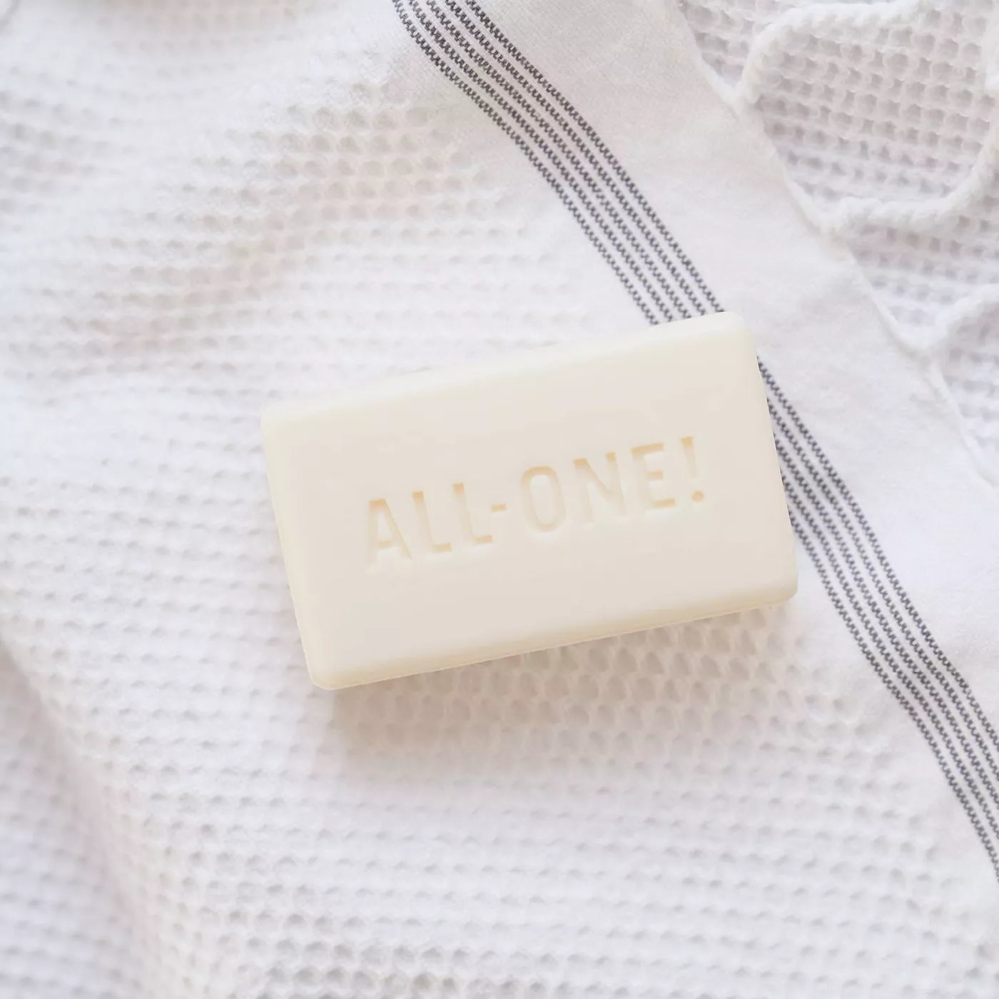 """Dr. Bronner's bar soap with """"ALL-ONE!"""" carved into the side"""