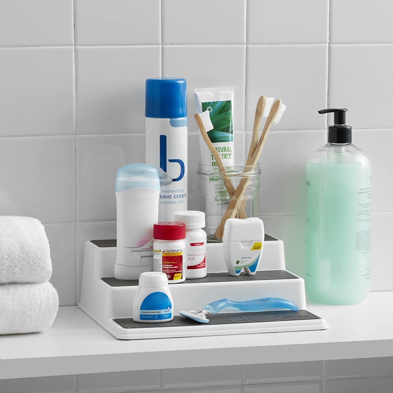 A tiered shelf holding bathroom essentials