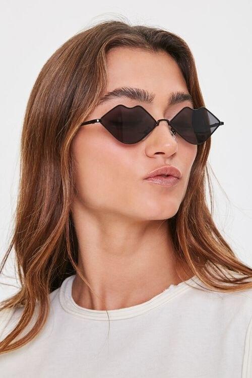 Model in lip shaped sunglasses