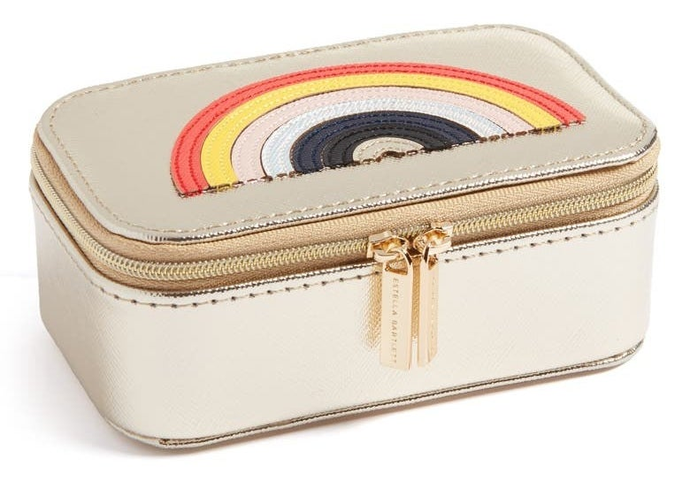 Gold rectangular zippered jewelry box with rainbow stitched on it