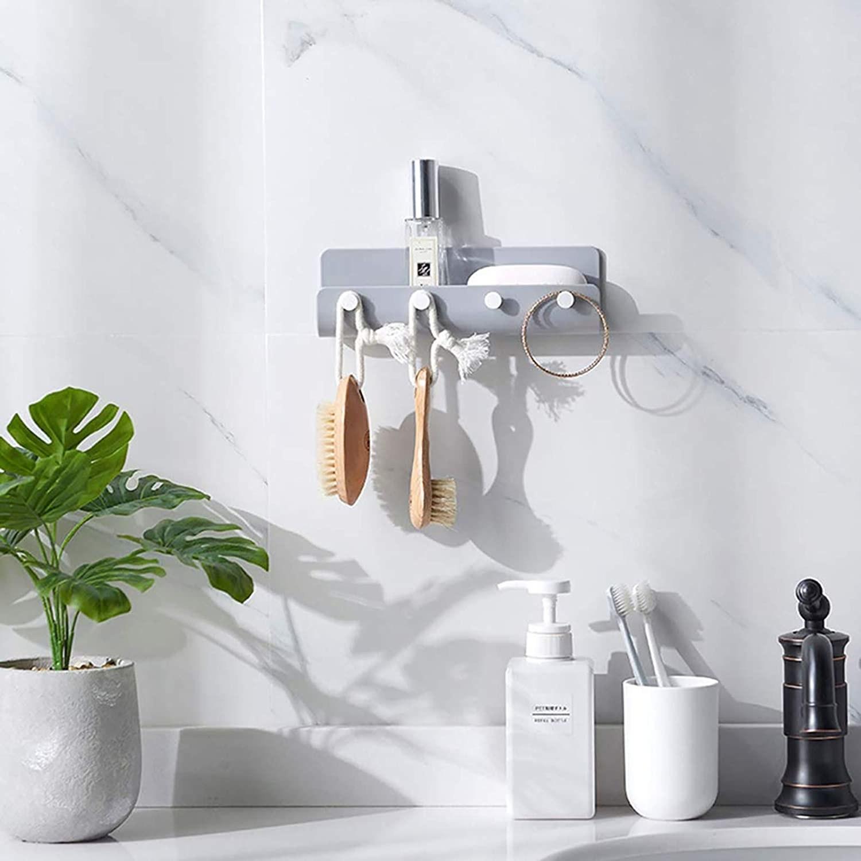A u-shaped organizer hung on a tiled bathroom wall above a vanity