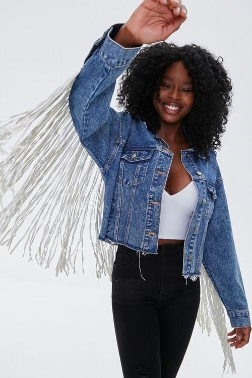 Model in fringe denim jacket