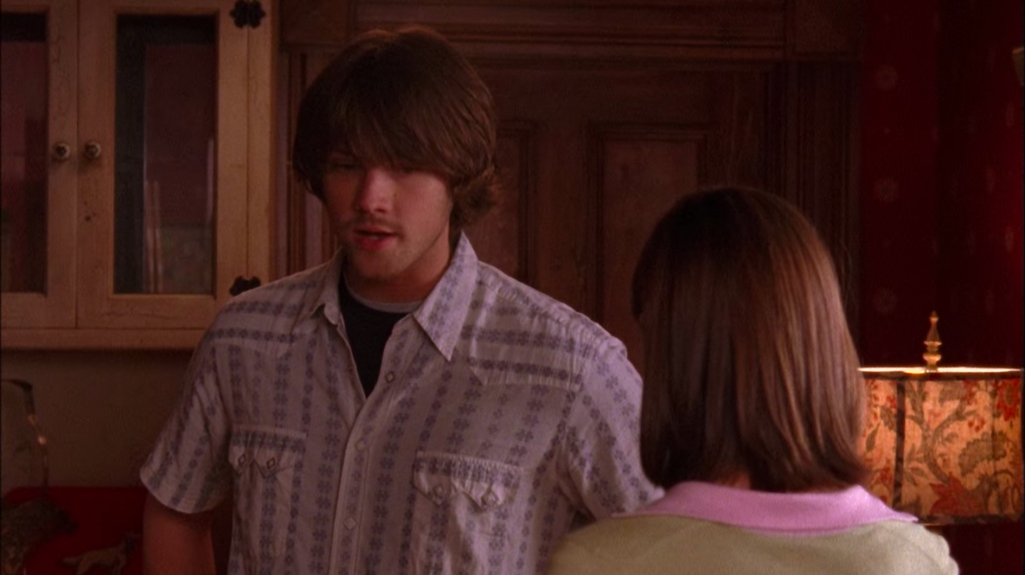 Dean with shaggy hair and weird facial hair