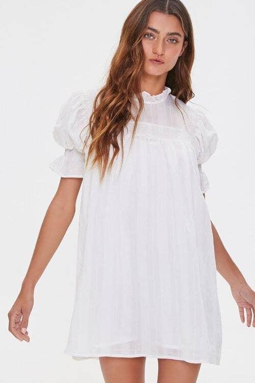 Model in white ruffle puff sleeve dress