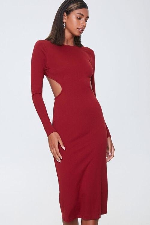 Model in open-back bodycon midi dress