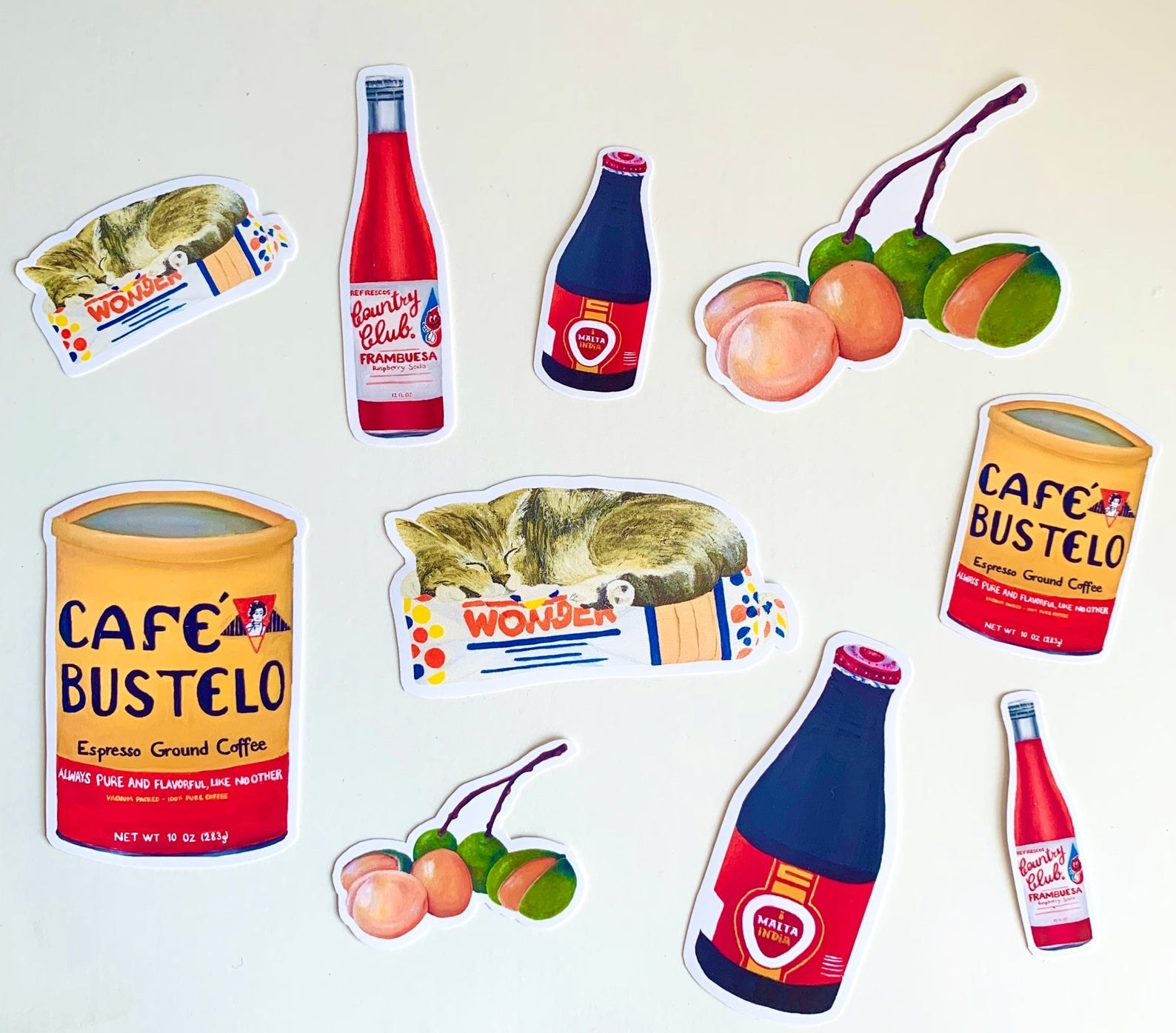 bodega-themed stickers with café bustelo, wonder bread, a bodega cat, quenapas, malta, and country club