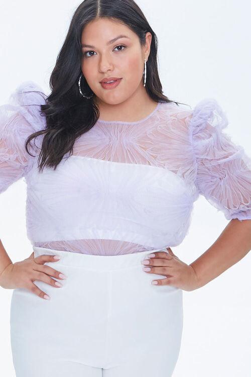 Model in embellished mesh top