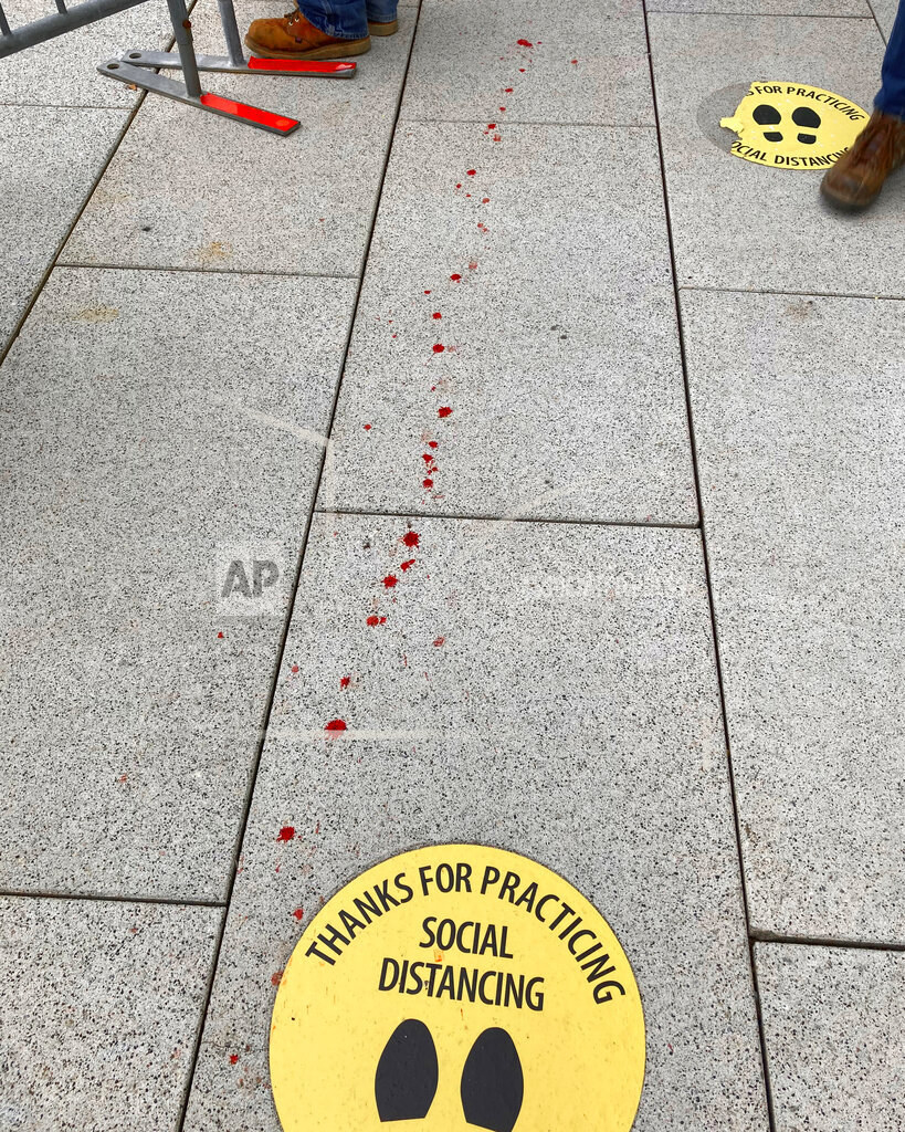 Blood is seen in a trail outside the Capitol