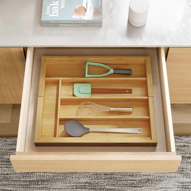 Bamboo drawer organizer inside drawer.