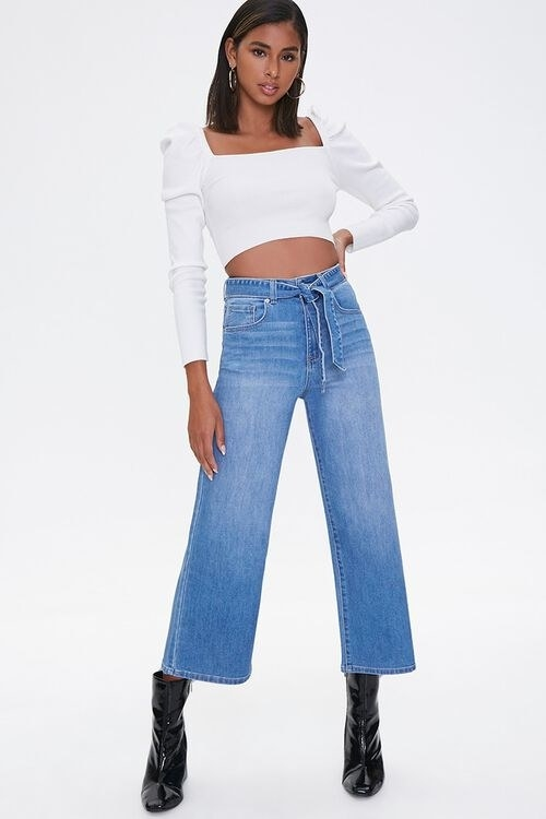 Model in recycled capri jeans and white top