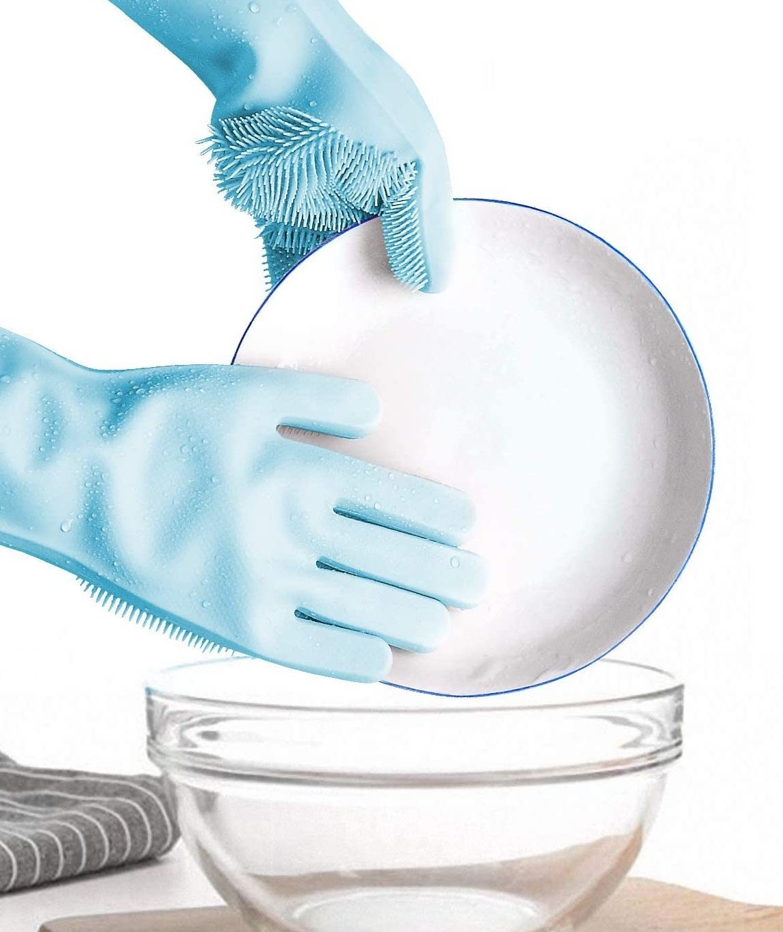 A person washing a plate while wearing silicone dish gloves