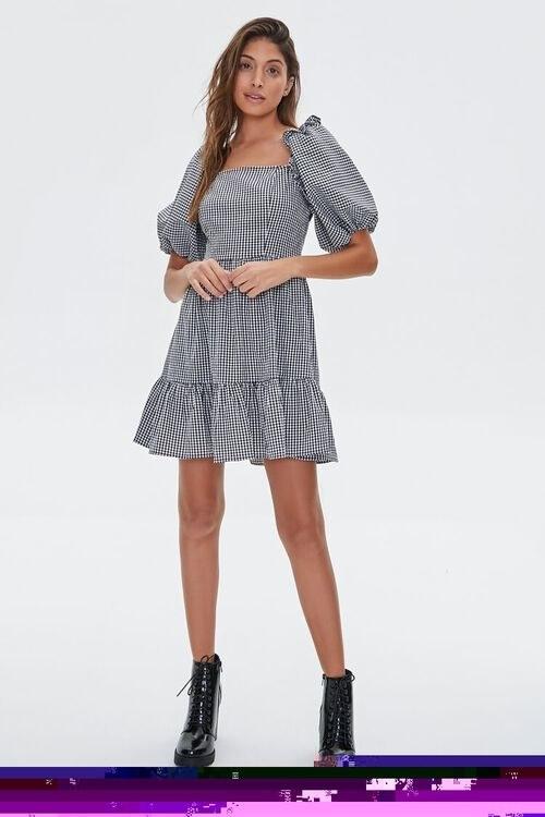 Model in gingham balloon sleeve dress