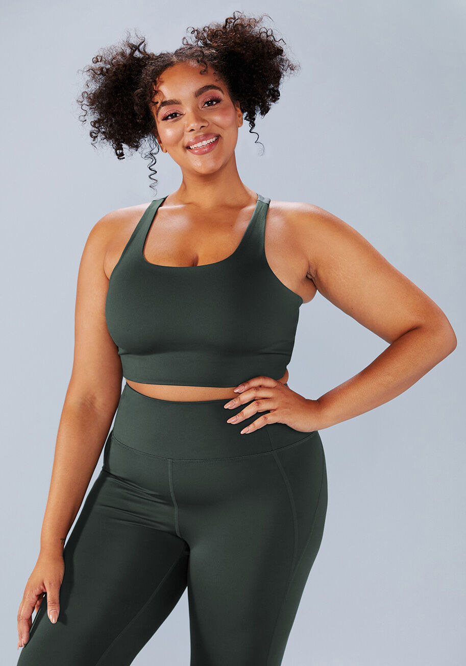 Model wears the moss green sports bra with matching leggings