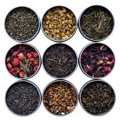nine different loose tea tins