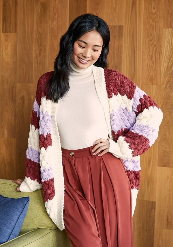 Model wears the burgundy, lilac and cream striped cardigan