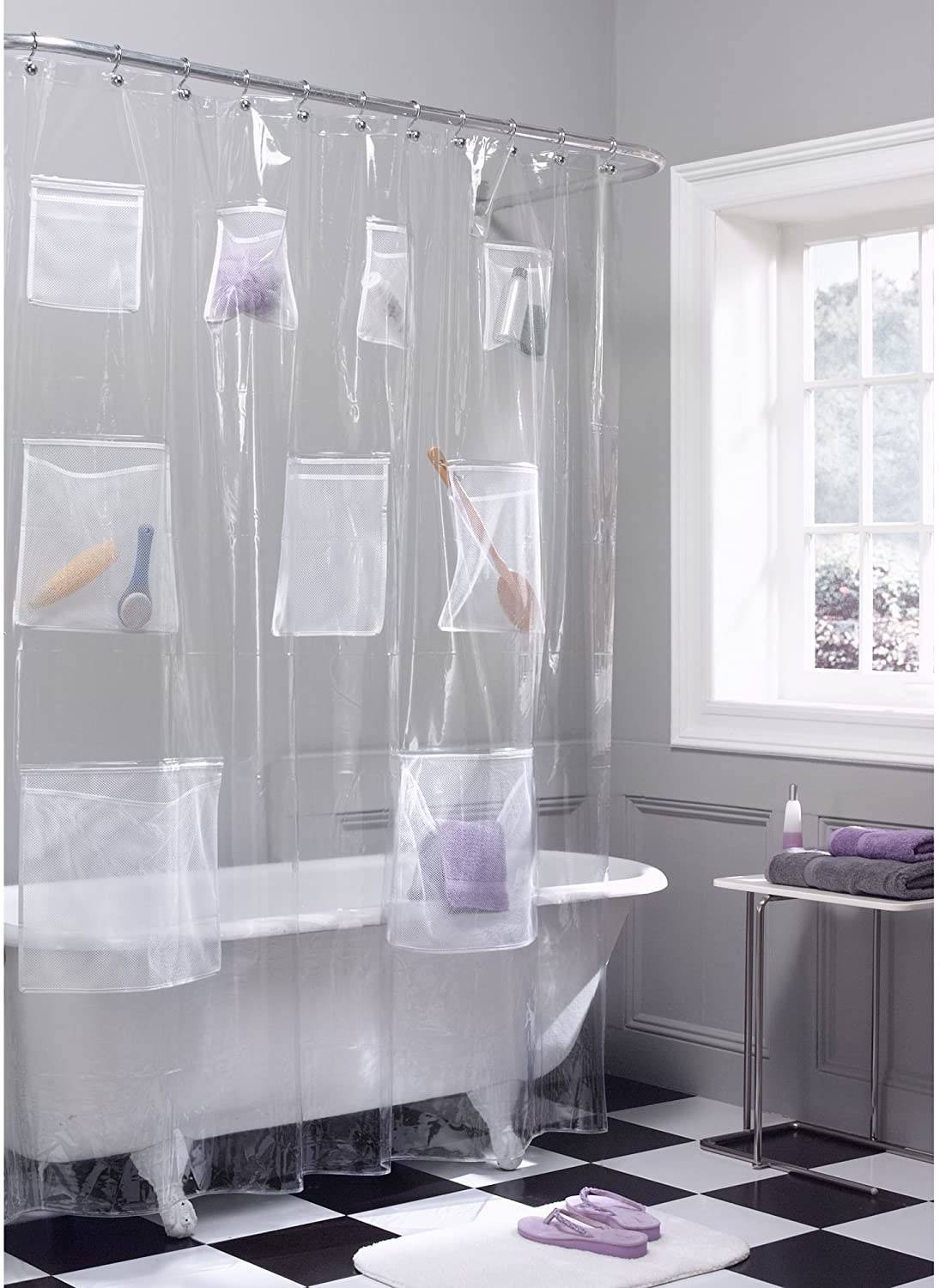 The mesh pocket shower curtain hanging around a claw foot tub