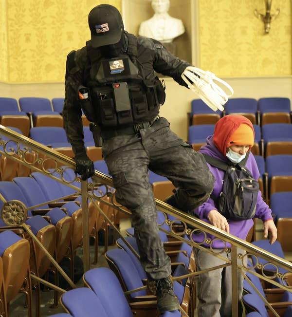 Rioter with zip-cuffs.