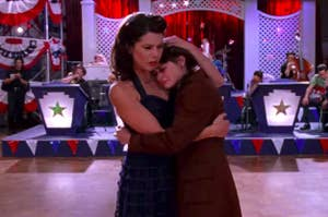 "On ""Gilmore Girls,"" Lorelai and Rory hug on a dance floor"