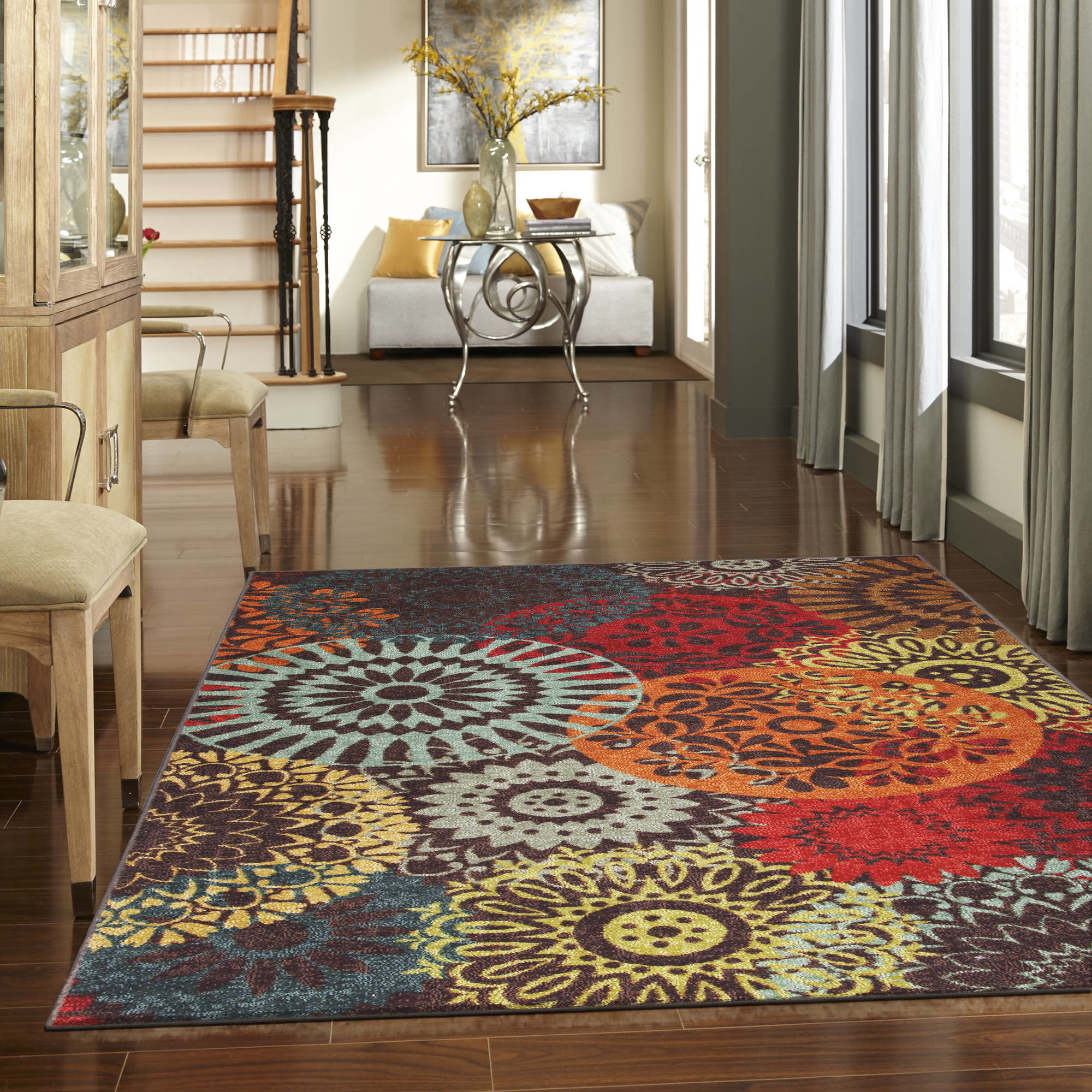 brown area rug with colorful circular designs