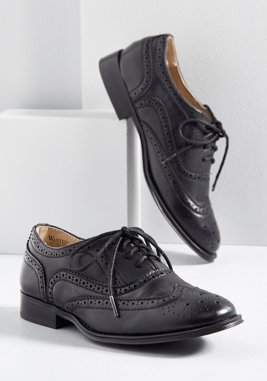 Black Oxford shoes with black laces and tan interiors