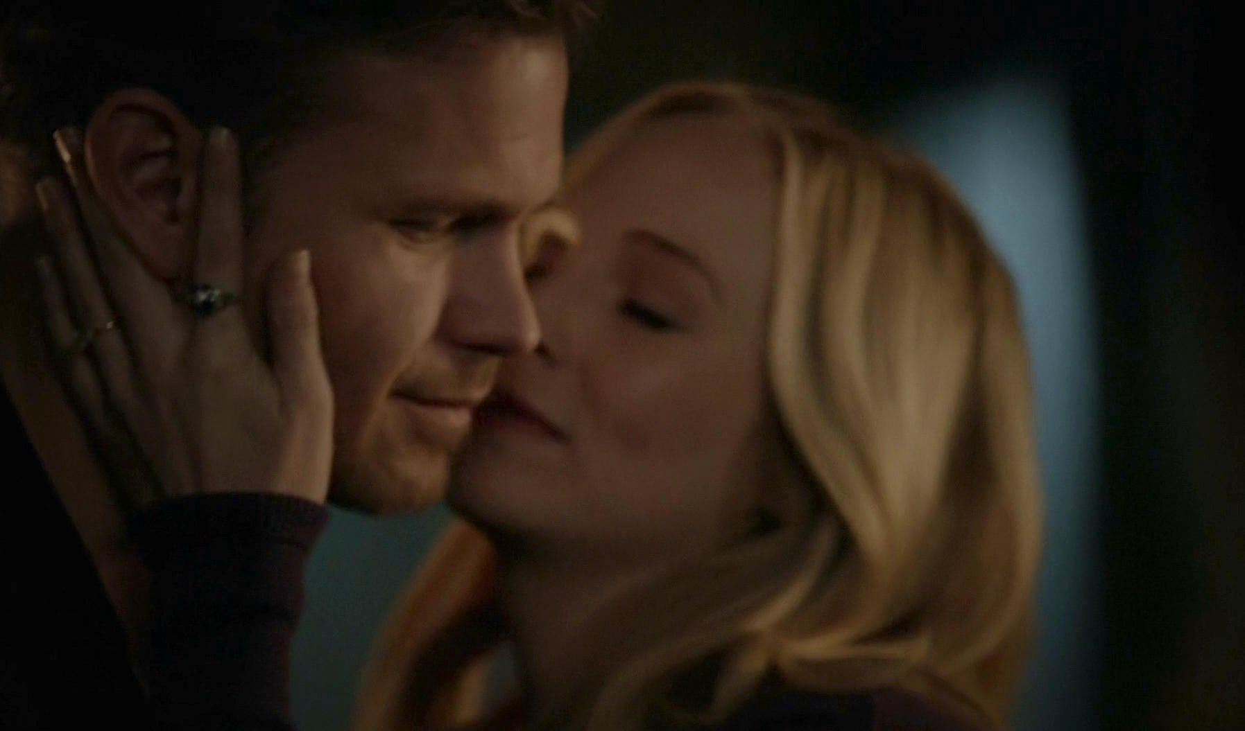Caroline embraces Alaric warmly with hand across his cheek