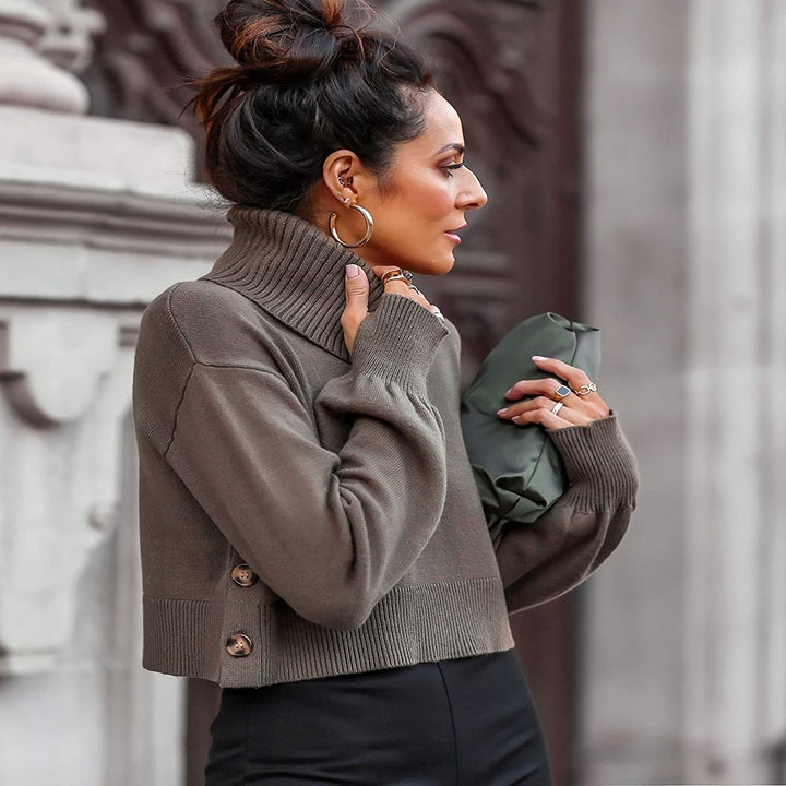 model wearing the gray turtleneck
