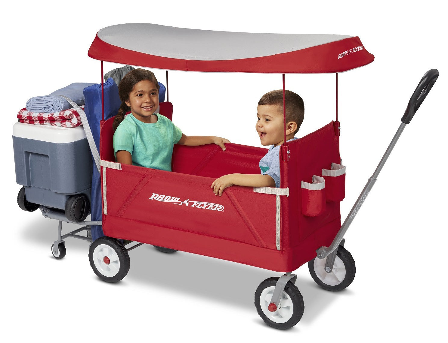two children riding in a red radio flyer wagon