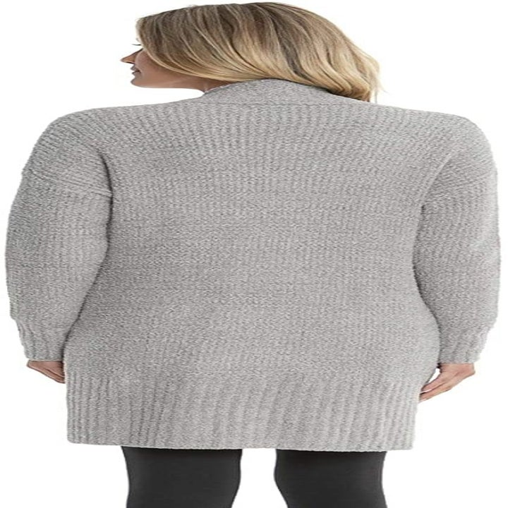 Back view of a model wearing the cardigan in pewter