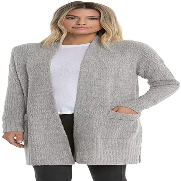 Front view of a model wearing the cardigan in pewter