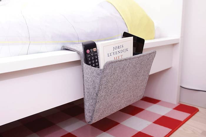 The bedside caddy positioned on the side of the bed